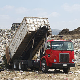 Truck unloading garbage at dumping ground