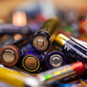 Short depth of field in blurred view to batteries of various brands.