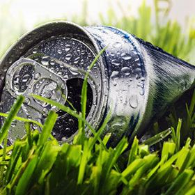 aluminum cans on a green grass