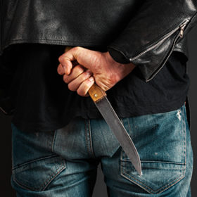 man hands with knife on gray background