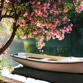 Boat on Ombla river near Rozat, Croatia