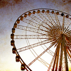 Ferris wheel with blue sky, photo in old image style