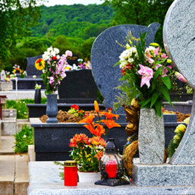 Tidied, well-kept cemetery with beautiful marble tombstones and colourful flowers.