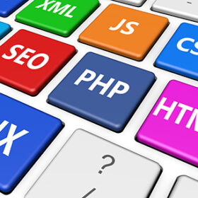 Web design, Internet and SEO development concept with programming language sign on colorful computer keyboard buttons.