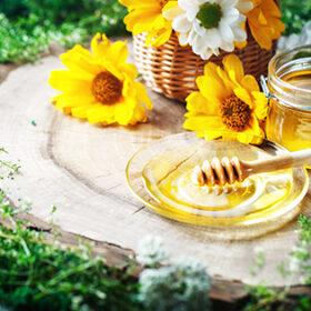 Fresh flower honey on a wooden table. Selective focus. Summer, autumn still life.