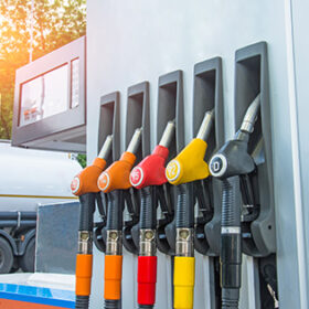 Gas station and filling guns for tank cars with different type of gasoline, rising fuel prices