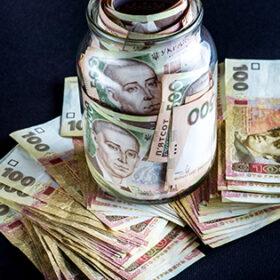 Ukrainian five hundred banknots in the jar on black background