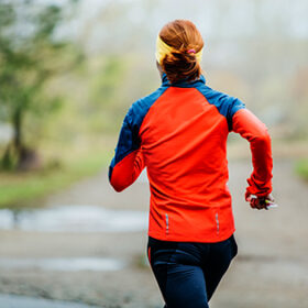 closeup of woman running in Park. rear view