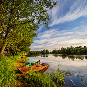 Two wooden boats on river Narew in sunset, Poland