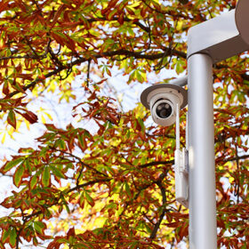 the surveillance camera on a lamp post