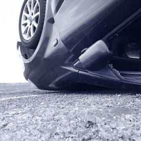 Car turned upsidedown after crash, detail. Monochromatic
