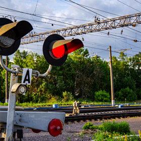 railway semaphore runs on level crossing