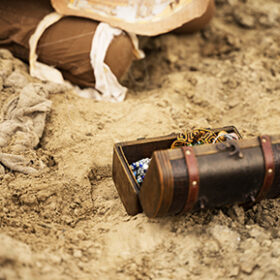 archaeologist excavates and searches for treasure using special items