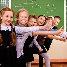 Happy schoolchildren at a classroom. Education.
