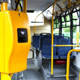 Yellow ticket validation machine on a modern public transport bus